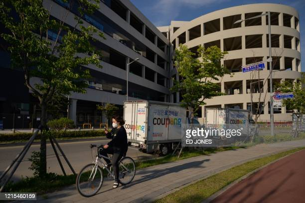 General view shows the warehouse of South Korean online delivery service Coupang, in Bucheon, south of Seoul, on May 27, 2020. - South Korea reported...