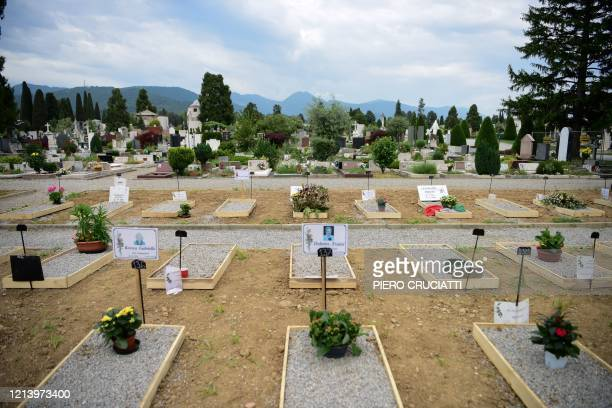 General view shows tombs at the Monumental Cemetery of Bergamo, Lombardy, a day after it reopened on May 19, 2020 as the country's is easing its...