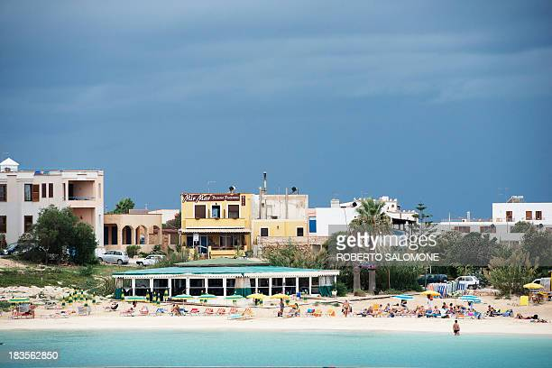 A general view shows tourists on a beach of the Lampedusa island on October 7 2013 Divers in Italy resumed the grim search for bodies today after a...