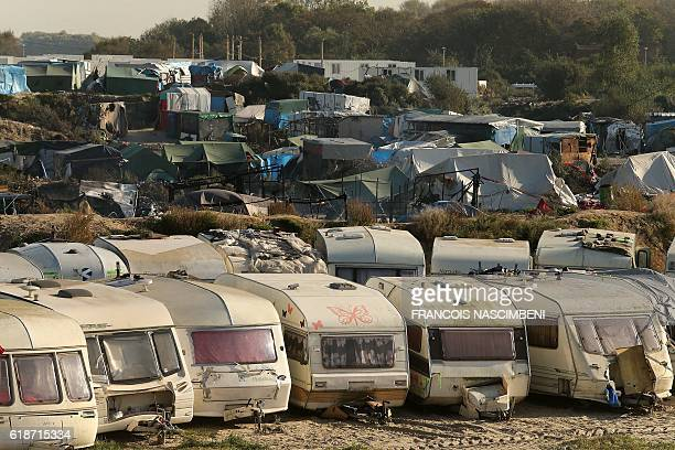 A general view shows trailer homes and tents at the Jungle migrant camp in Calais in northern France on October 28 2016 Migrants left behind after...