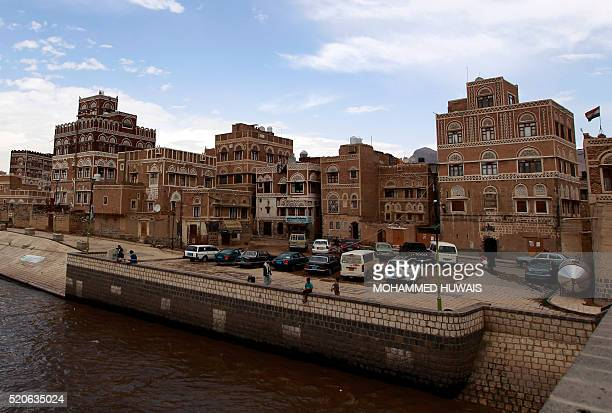 A general view shows UNESCOlisted buildings in the old city of the Yemeni capital Sanaa following heavy rainfall on April 12 2016 / AFP / MOHAMMED...