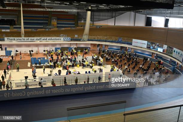 General view shows various activities as people receive a dose of the BioNTech/Pfizer covid-19 vaccine at a vaccination clinic set up inside the...