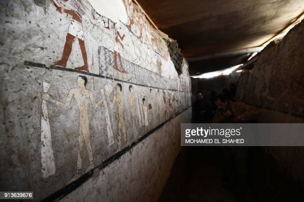 A general view shows wellpreserved and rare wall paintings inside the tomb of an Old Kingdom priestess on the Giza plateau on the southern outskirts...
