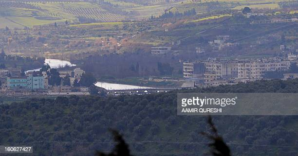 A general view showsview of the Roman bridge of Jisr alShughur a northern Syrian city under the control of proregime troops near the border with...