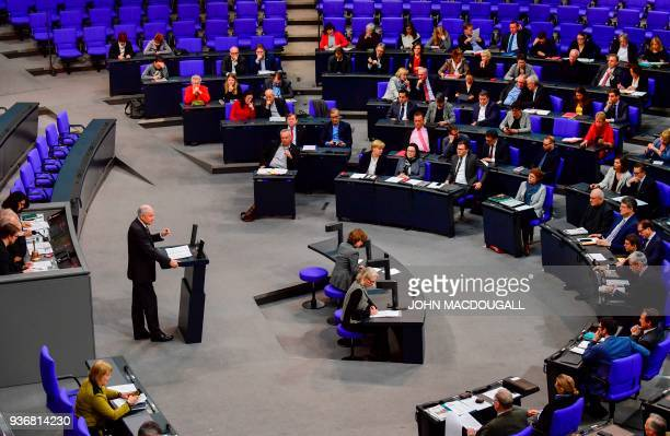 General view taken as German Interior Minister Horst Seehofer addresses the lower house of parliament the Bundestag during a session on MArch 23 2018...