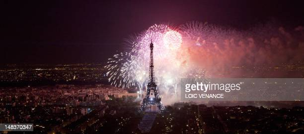 A general view taken at night shows Paris and the Eiffel Tower during the firework as part of the annual Bastille Day celebrations on July 14 2012 in...