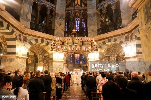 TOPSHOT General view taken during the mass at the Cathedral of Aachen attended by the German Chancellor and the French President among many others on...