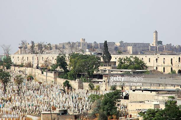 A general view taken from Aleppo's Syrian regimecontrolled neighbourdhood of Karm alJabal shows the warwracked city's historic citadel in the...