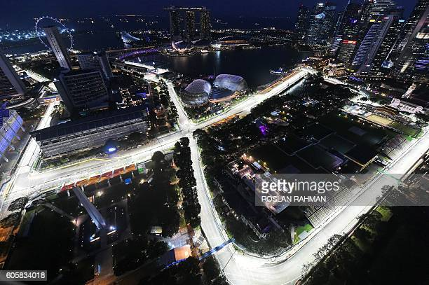 TOPSHOT A general view taken from Swissotel The Stamford shows the lit circuit for the upcoming Formula One Singapore Grand Prix night race on...