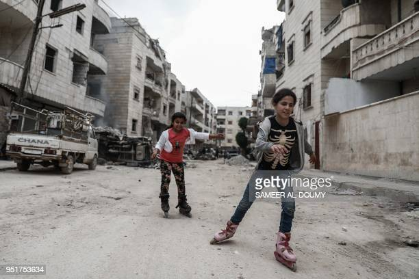 A general view taken on April 26 shows children rollerblading in the street in the northern Syrian enclave of Afrin that Ankarabacked forces captured...