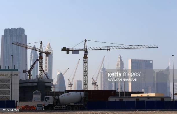 A general view taken on April 27 2016 shows construction sites in Dubai For more than 10 years Dubai property prices have been on a roller coaster...