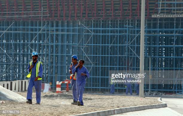 A general view taken on April 27 2016 shows foreign workers at a construction site in Dubai For more than 10 years Dubai property prices have been on...