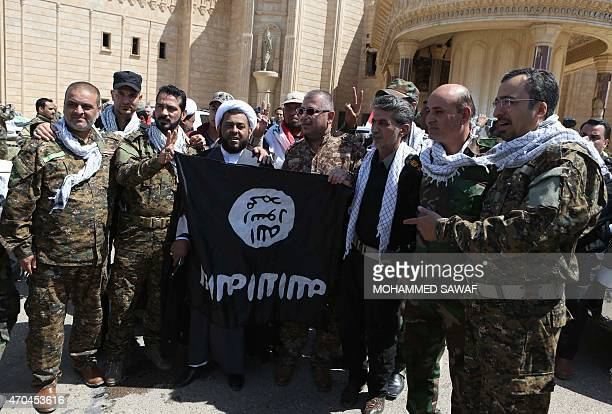 A general view taken on April 5 2015 shows members of the Popular Mobilisation units paramilitary forces that are dominated by Iranbacked Shiite...