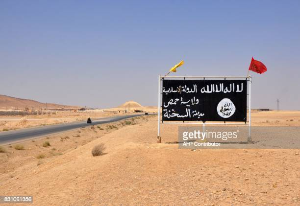 A general view taken on August 13 2017 shows an Islamic State group poster in the central Syrian town of AlSukhnah on August 13 2017 as progovernment...