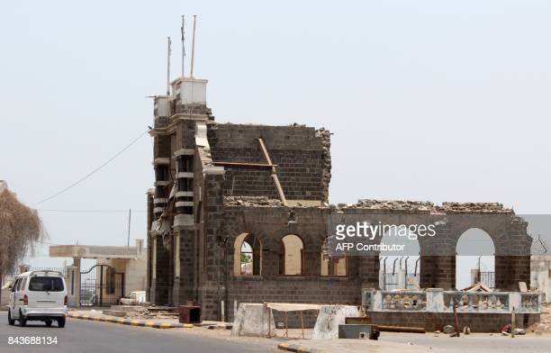 A general view taken on August 2 2017 shows a historical builiding in AlTawahi west of Aden which has been heavily damaged in the clashes between the...