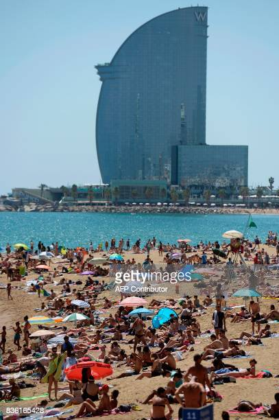 A general view taken on August 21 2017 shows the Barceloneta beach of Barcelona with tourists and residents enjoying a sunny day four days after the...