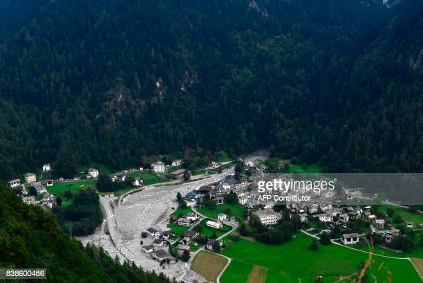 A general view taken on August 24 2017 shows houses covered by stones after a landslide struck during the night of August 23 in the village of Bondo...