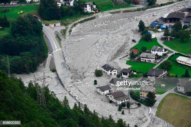 A general view taken on August 24 2017 shows the village of Bondo Switzerland covered by stones after a landslide struck during the night of August...