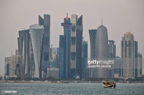 General view taken on December 20, 2019 shows boats moored in front of the skyline of the Qatari capital, Doha.