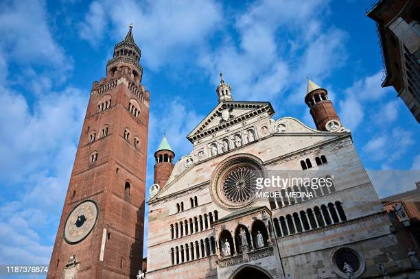 General view taken on December 8, 2019 in Cremona shows the Cathedral, dedicated to the Assumption of the Blessed Virgin Mary, and its Bell Tower,...