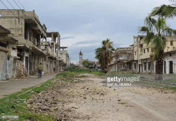 TOPSHOT A general view taken on February 13 2018 shows the destruction in one of Houla's deserted streets with the Syrian rebelheld town's damaged...