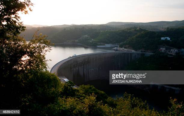 A general view taken on February 19 2015 shows the Kariba Dam wall between Zimbabwe and Zambia on the eve of the signing of $294 million in deals...