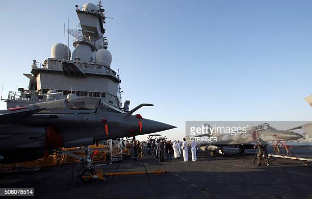 A general view taken on January 21 2016 shows Rafale and Super Etendard fighter jets on the flight deck of the French aircraft carrier Charles de...