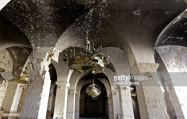 A general view taken on January 22 2017 shows damaged arches in the Umayyad Mosque in the old city of Aleppo a month after government forces retook...