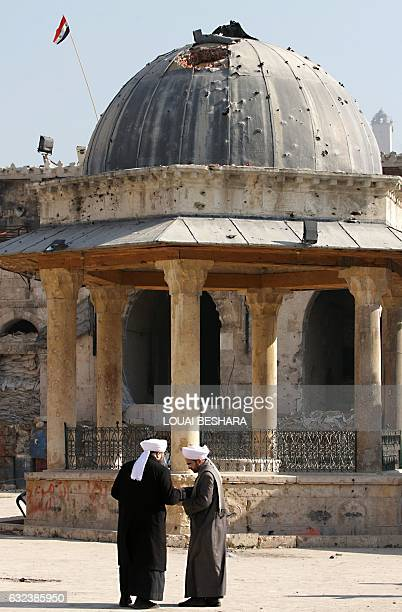 A general view taken on January 22 2017 shows religious clerics standing at the ancient Umayyad Mosque in the old city of Aleppo a month after...