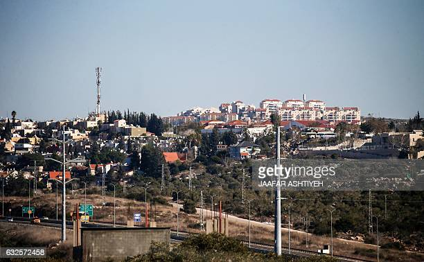 CORRECTION A general view taken on January 23 2017 from the Palestinian West Bank village of Hares south of the city Nablus shows the Israeli Jewish...