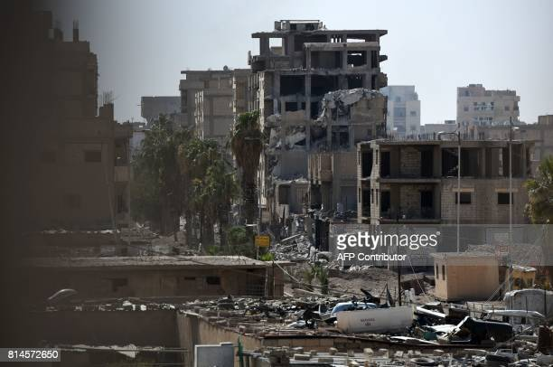 A general view taken on July 14 shows damaged street in eastern Raqa as USbacked forces continue their offensive to retake the city from Islamic...