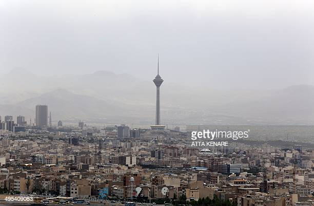 A general view taken on June 3 2014 shows Milad Tower the day after a sandstorm engulfed the northeastern neighbourhood of Minicity in the Iranian...
