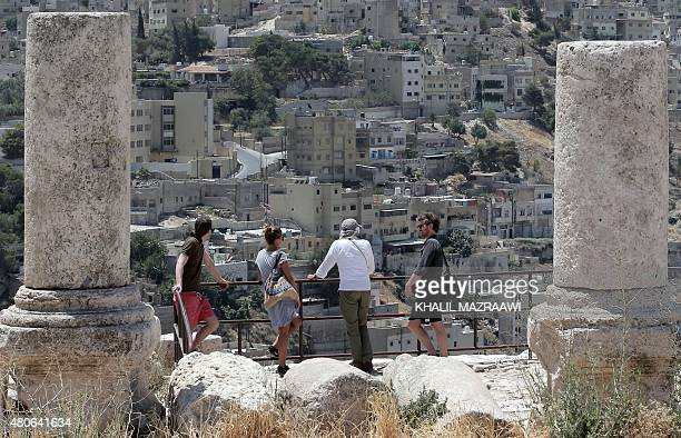A general view taken on June 30 2015 shows tourists visiting the ruins Jabal AlQala'a in the Jordanian capital Amman Jordan a small haven of peace...