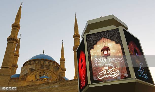 A general view taken on June 5 2016 shows a large lantern decorating the street in front of the Mohammad alAmin Mosque in downtown Beirut as Muslims...