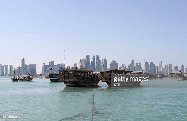 A general view taken on June 5 2017 shows boats sitting in the port along the corniche in Doha Arab nations including Saudi Arabia and Egypt cut ties...