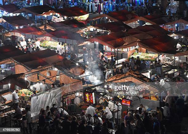 A general view taken on June 5 shows the Jemaa elFna square in Marrakesh At dusk the square comes alive and is packed with thousands of people who...