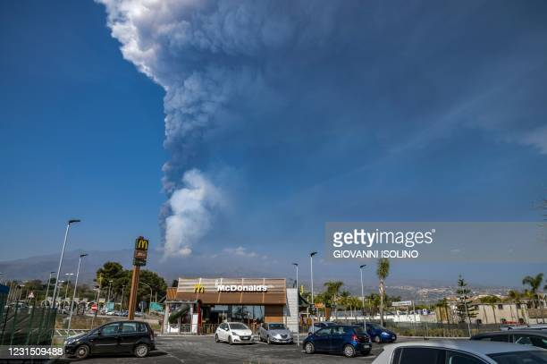 General view taken on March 04, 2021 from Giarre, north of Catania, Sicily, shows the Mount Etna volcano spewing smoke. - Mount Etna, one of the...