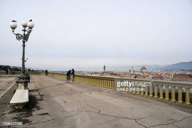 A general view taken on March 10 2020 from a deserted Piazzale Michelangelo shows the city of Florence Tuscany as Italy imposed unprecedented...