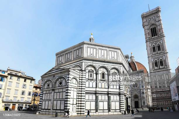 General view taken on March 10, 2020 shows the deserted Piazza del Duomo in Florence, Tuscany, with the Battistero di San Giovanni and the Santa...