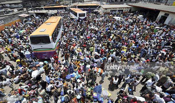General view taken on March 19 2011 shows residents of Abidjan streaming into Adjame's bus station to flee deadly violence in Abidjan as a...
