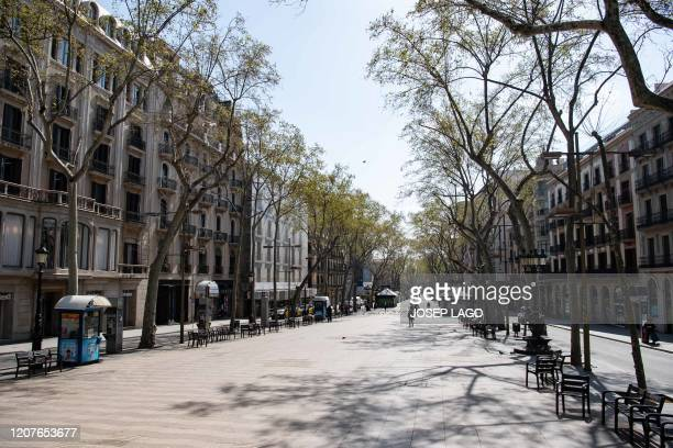 General view taken on March 19, 2020 of Las Ramblas in Barcelona. - Spain announced deaths due to the novel coronavirus had risen about 30 percent...