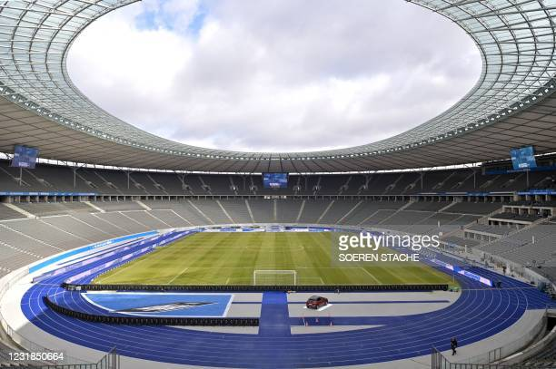 General view taken on March 21, 2021 shows the Olympic Stadium with empty stands prior to the German first division Bundesliga football match between...