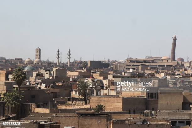 A general view taken on March 25 shows the Mosul skyline featuring the historic leaning minaret in the vicinity of the Great Mosque of AlNuri in...