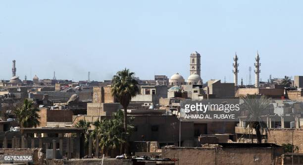 A general view taken on March 25 shows the Mosul skyline featuring the minarets of the Great Mosque of AlNuri in Mosul where Islamic State group...