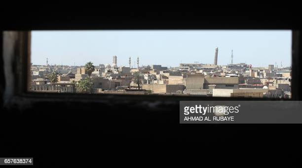 A general view taken on March 25 shows the Mosul skyline featuring the historic leaning AlHadba minaret near the Great Mosque of AlNuri in Mosul...