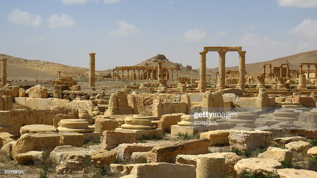 A general view taken on March 27, 2016 shows part of the ancient city of Palmyra, after government troops recaptured the UNESCO world heritage site from the Islamic State (IS) group. President Bashar al-Assad hailed the victory as an 'important achievement' as his Russian counterpart and key backer Vladimir Putin congratulated Damascus for retaking the UNESCO world heritage site. / AFP / STRINGER