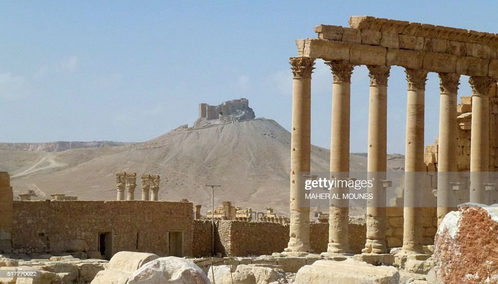 A general view taken on March 27, 2016 shows part of the ancient city of Palmyra with the citadel in the background, after government troops recaptured the UNESCO world heritage site from the Islamic State (IS) group. President Bashar al-Assad hailed the victory as an 'important achievement' as his Russian counterpart and key backer Vladimir Putin congratulated Damascus for retaking the UNESCO world heritage site. / AFP / Maher AL