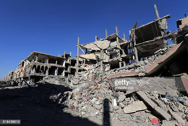 A general view taken on March 31 2016 shows destruction in a residential neighbourhood in the adjacent modern town to the ancient Syrian city of...
