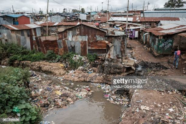A general view taken on May 25 2018 shows the litter in the drainage with the slum in background during the community cleanup event supported by UN...