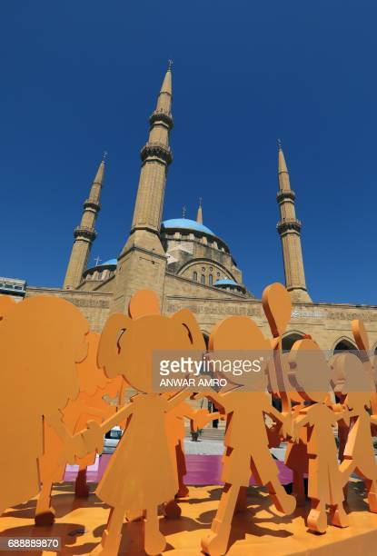 A general view taken on May 27 2016 shows Ramadan decorations in the street in front of the Mohammad alAmin Mosque in downtown Beirut as Muslims...